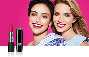 Close up of two women smiling and wearing lipstick in the shade that benefits Mary Kay initiative Pink Changing Lives.