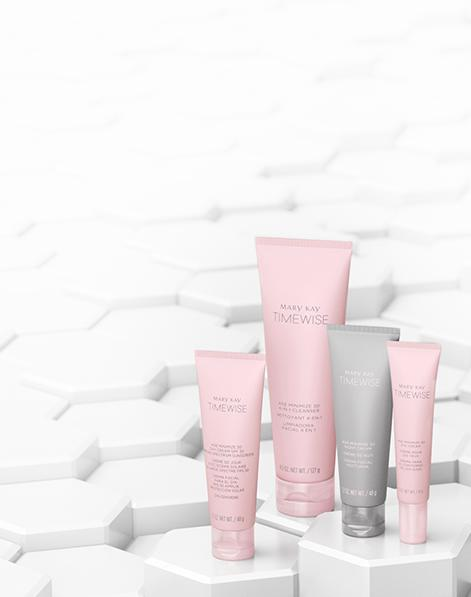 The new Mary Kay® TimeWise® Miracle Set 3D™ products are showcased on white hexagonal pedestals.