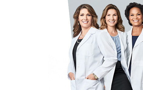 Image of three scientists in lab coats.