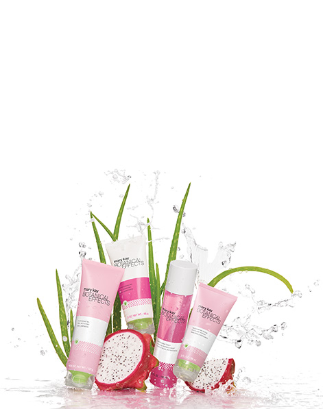 Image of the Botanical Effects regimen accompanied by aloe leaves and dragon fruit on white background.