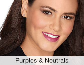 A smiling woman is wearing a Mary Kay® makeup look that features purple and neutral eye shadow shades and a berry blush and lipstick for a perfectly pretty look.