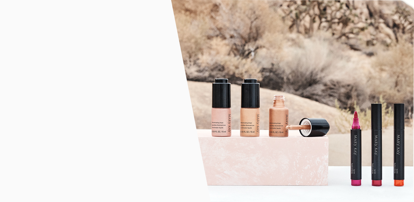 Three Mary Kay® Lip Tints and three Mary Kay® Illuminating Drops are shown with a desert backdrop.