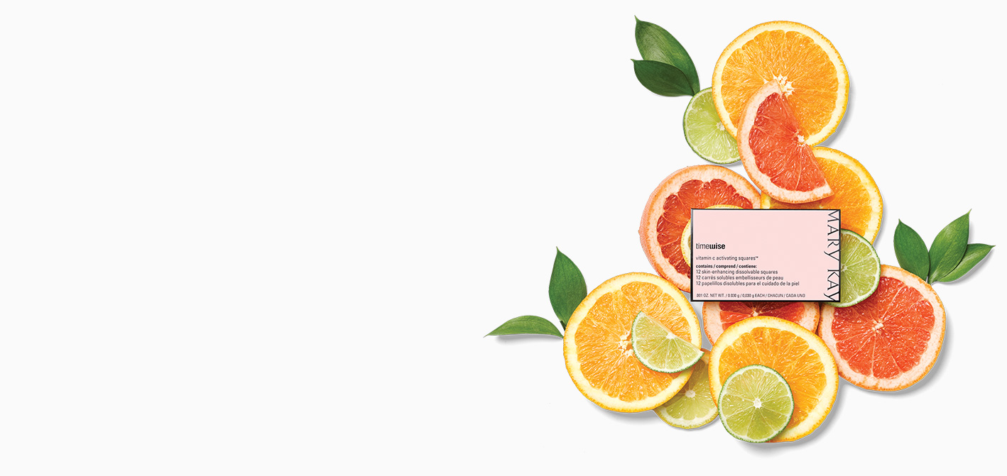 TimeWise Vitamin C Activating Squares® packet styled on top of citrus rounds and leaves against a white background.