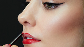 Mary Kay Lip Liner in Red being applied to model's lips.