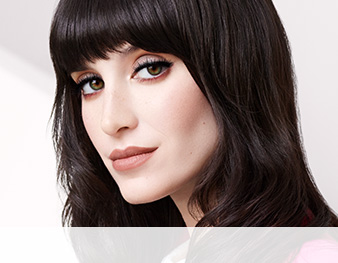 Close-up of model wearing Feel Fierce makeup artist look from Mary Kay against a white background