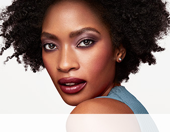 Close-up of model wearing Plum Passion makeup artist look from Mary Kay against a white background
