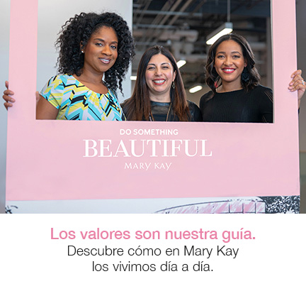Three Mary Kay employees holding posing behind photo frame.