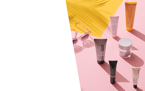 Mary Kay® SPF products styled with sunglasses against pink and yellow background.