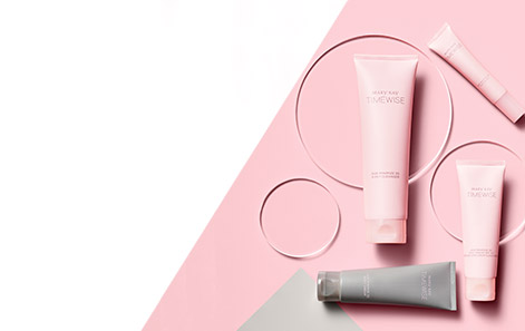 Mary Kay TimeWise Miracle Set 3D® products set against a pink background with three clear disks.