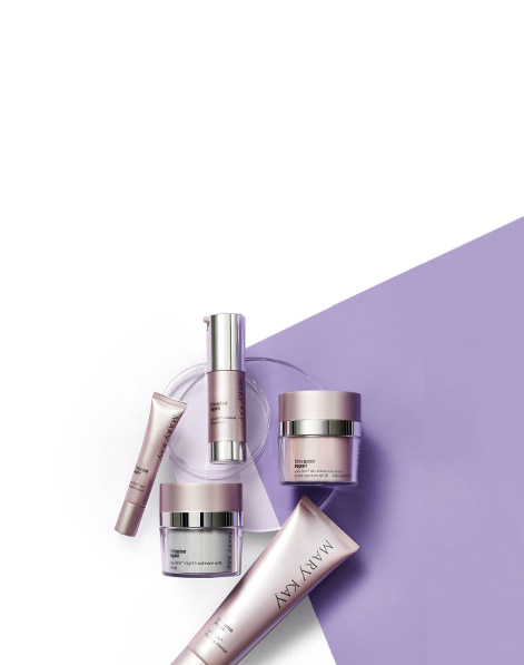 Mary Kay TimeWise Repair® Volu-Firm® Set products displayed against a purple background atop two clear discs.