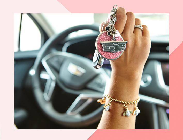 Mary Kay Cadillac driver holding up key chain