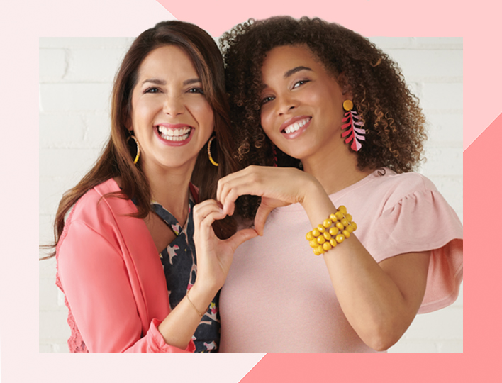 Mary Kay models holding up hands to form a heart