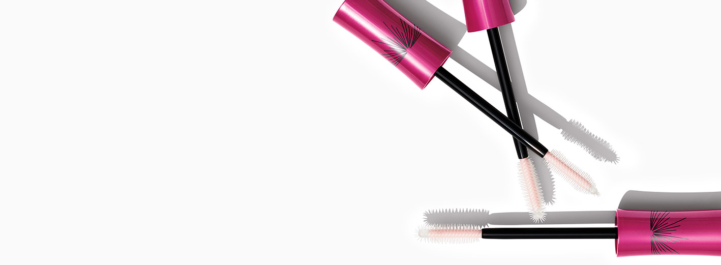 Lash Love Fanorama™ Mascara from Mary Kay with wands and tubes crossed on each other against white background.