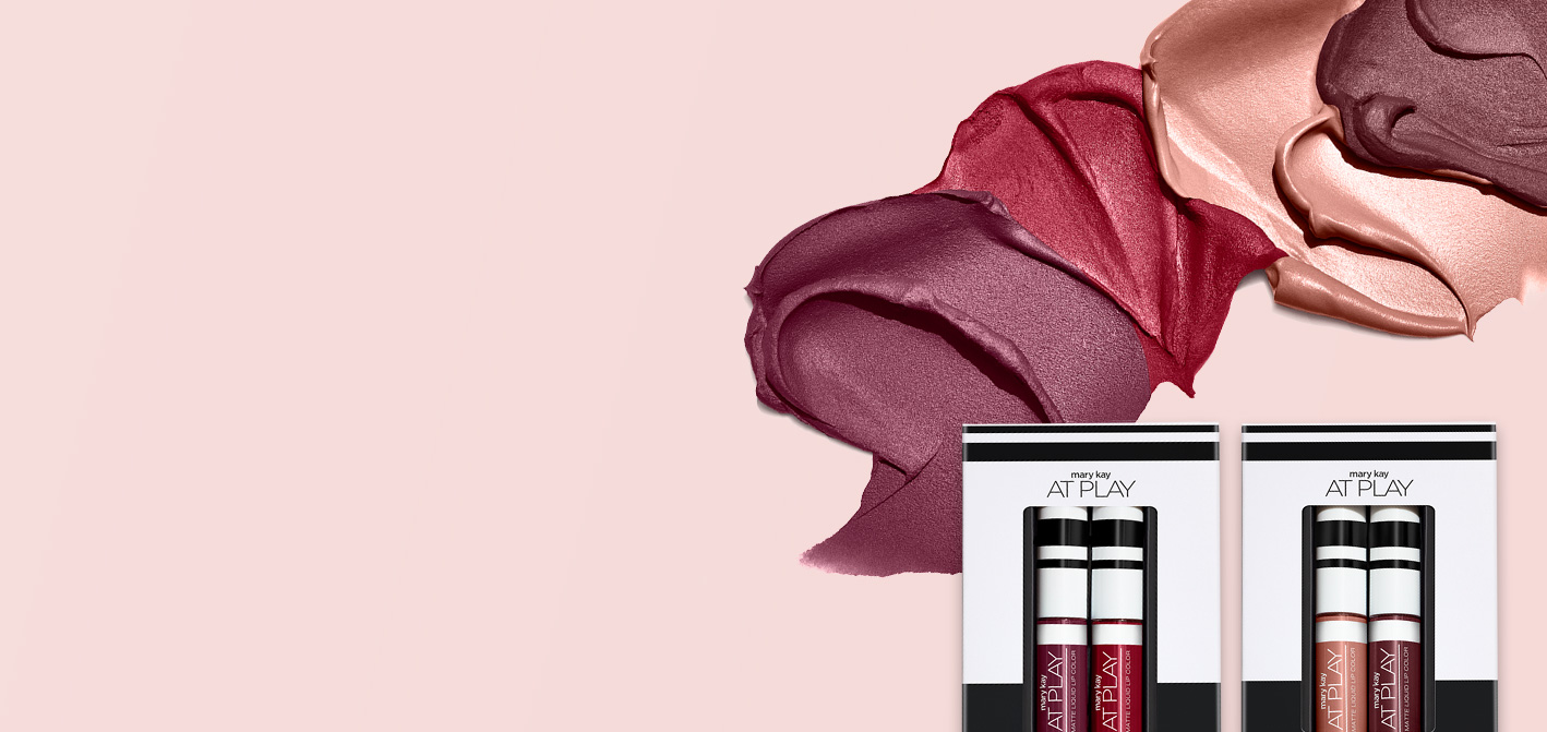 All four product swatches from the limited-edition†  Mary Kay At Play® Mini Matte Liquid Lip Color Kits are set against a pink background. Both kits, featuring two matte lip shades each, are in the foreground.