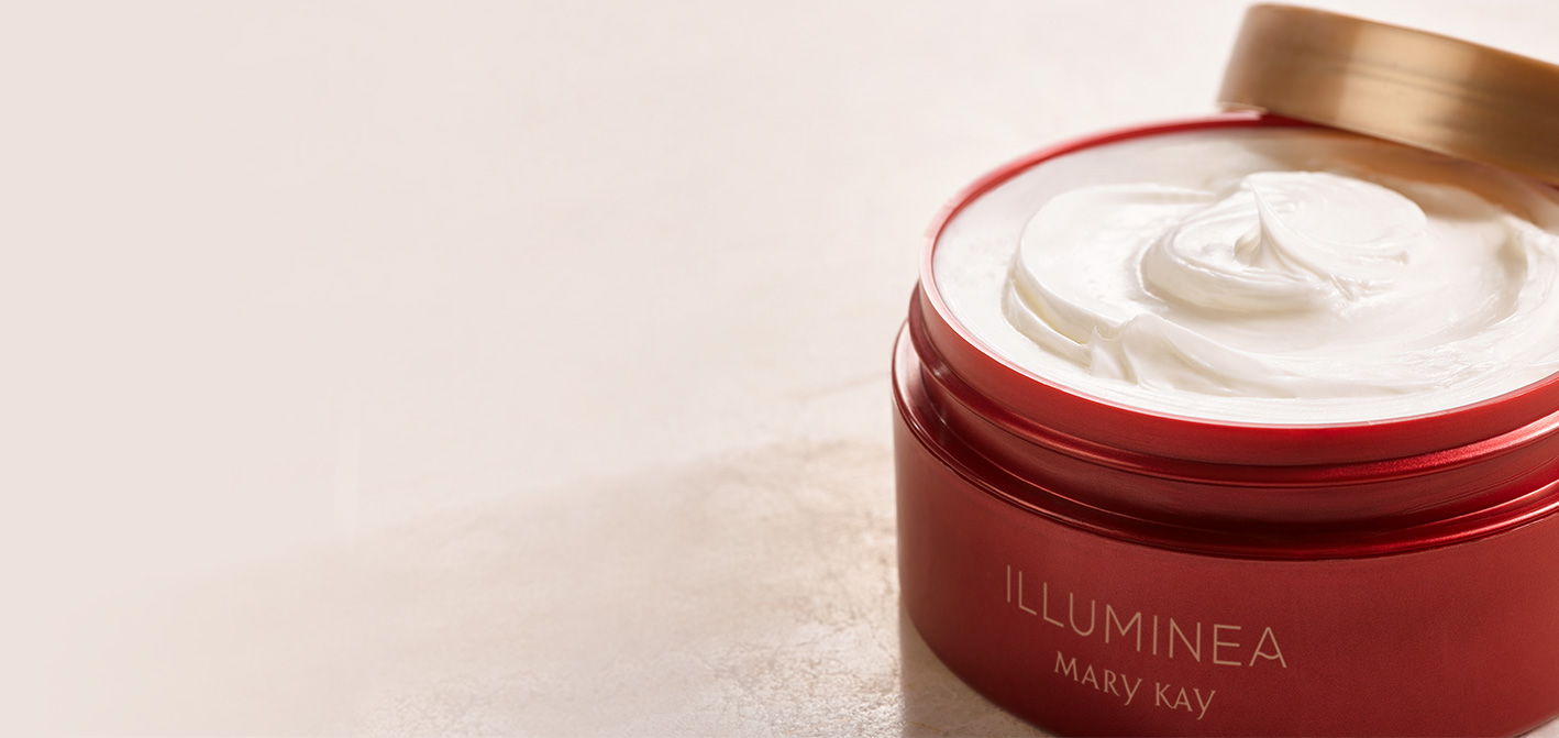 Close-up shot of Mary Kay Illuminea™ Body Soufflé with the lid off and creamy white product exposed