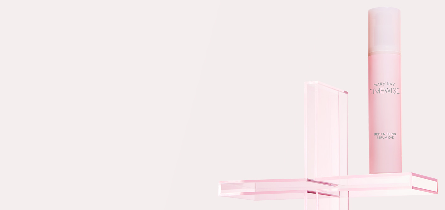 Close-up product shot of pink TimeWise Replenishing Serum C+E™ bottle, situated on top of a clear pink plus sign, set against a light pink background