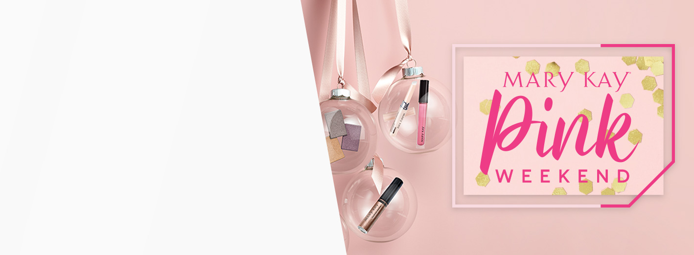 Image of beauty products hanging in clear baubles from pink satin ribbons, staged  against a pink background