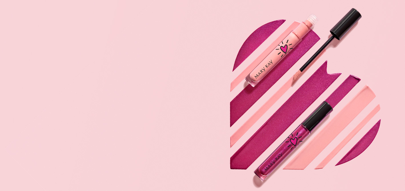 Limited-editionᵻ Mary Kay Unlimited™ Lip Gloss shades arranged in shape of a heart with a closed tube and open tube and applicator